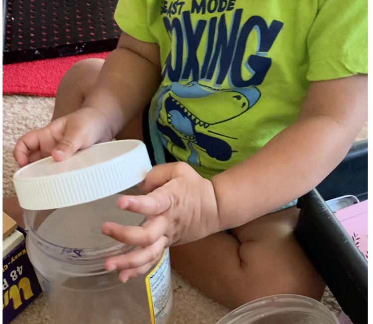 Activity with containers for infants